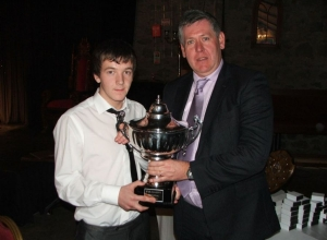 Minor Captain Ronan Delargy receives Laverty cup from South West Chairman Columb Walsh