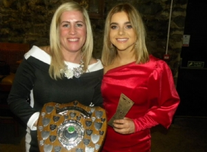 Roisin Kelly receives The Teresa Grant Memorial Trophy for Senior POTY from Siobhan Grant McAfee