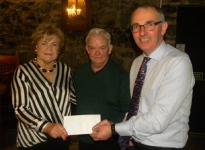 Geraldines Chair, Marie Doherty , and Casements Chair, Sean McAleese, Present a donation to Saffron Gael